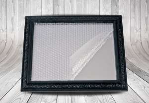 Bubble mask with one side with adhesive used for picture frame.