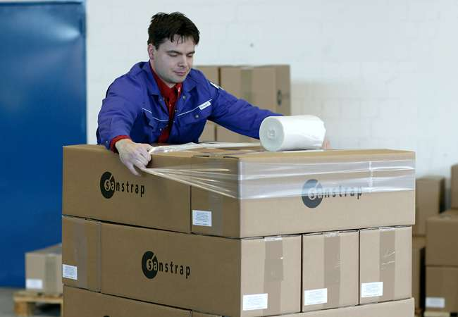 Pallet being wrapping Sanstrap, an adhesive band to stabilise your pallet