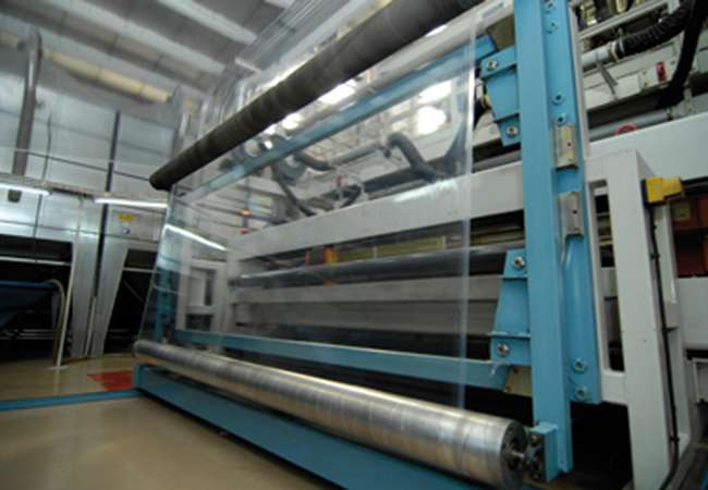Stretch film machine at manufacturing facility.