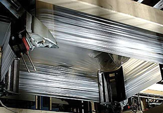 Pallet getting wrapped using a stretch film hood