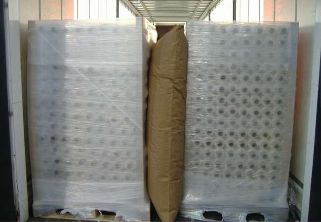 Air Bags placed between pallets in container ready for transport