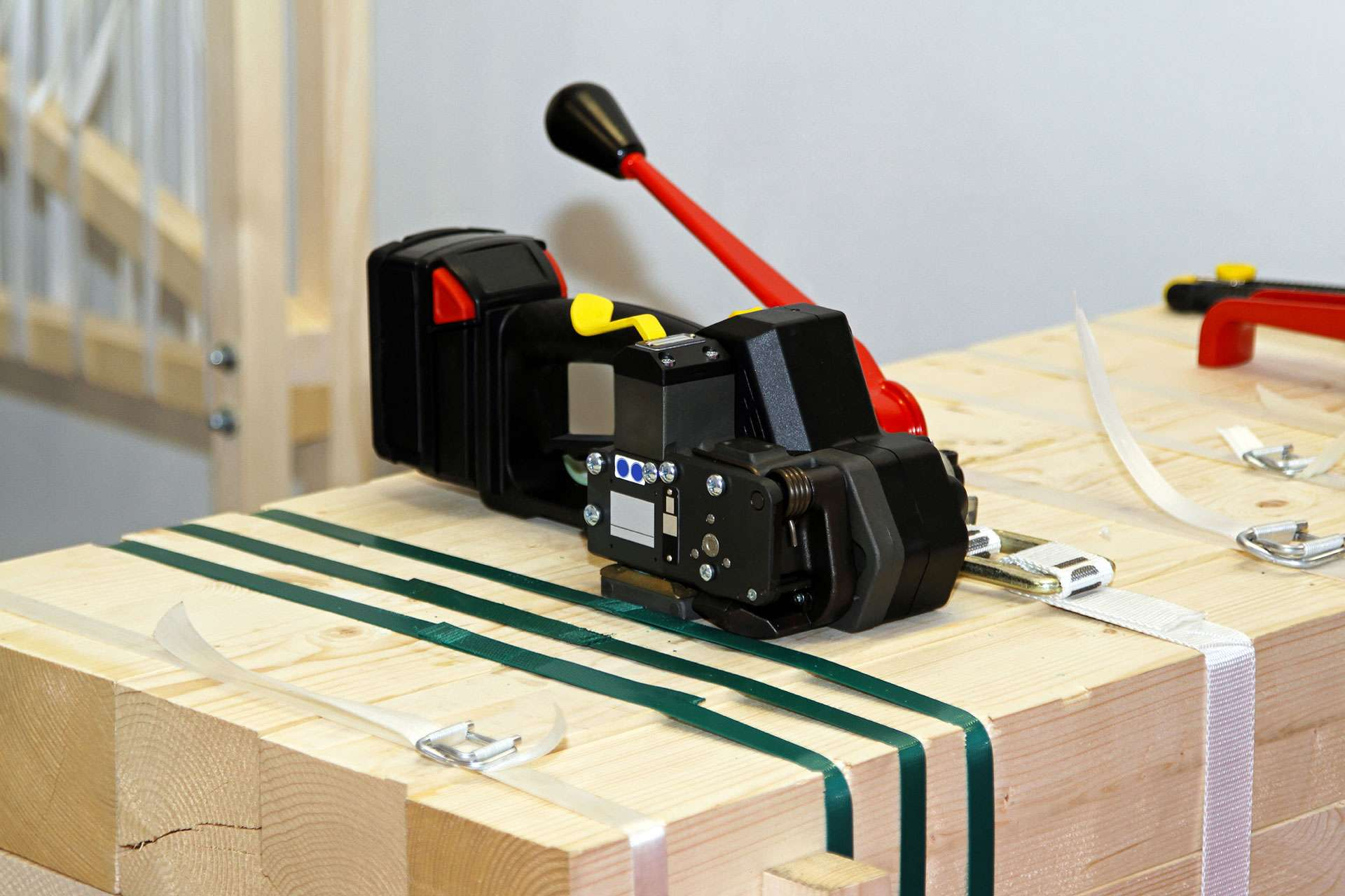 Strapping and strapping tools on pallet.